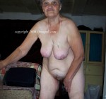 old amateur granny showing off saggy tits